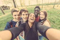 stock-photo-58978862-group-of-multiethnic-teenagers-taking-a-selfie-at-park
